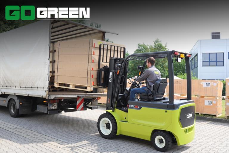man loading pallets on truck